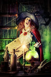 Fantasy witch. Attractive witch in the wizarding lair. Fairytales. Halloween Royalty Free Stock Photography