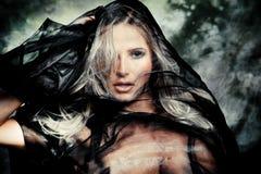 Fantasy woman. Blond woman with black veil studio shot Royalty Free Stock Photos