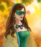 Fantasy woman, beautiful snow queen in green mask.Autumn snow Royalty Free Stock Images