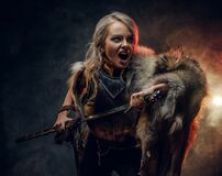 Fantasy Woman Knight Wearing Cuirass And Fur, Holding A Sword And Rushes Into Battle With A Furious Cry. Cosplayer As Royalty Free Stock Images