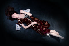 Fantasy woman lying on the ground with sword Royalty Free Stock Images