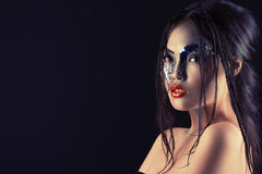Fantasy woman. Portrait of an asian model with fantasy make-up. Black background Stock Photo