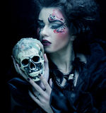 Fantasy woman with skull. Halloween theme. Stock Photography
