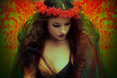 Fantasy woman with wreath of flowers stock photo