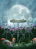 Fantasy wonderland. Fantasy scenery with a table, chairs and mushrooms Stock Photos