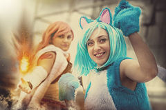 Fantasy world. Disguised cosplay women. Two imaginative characters of the fictional world. A young girl dressed as a cat and another girl with a hand that Royalty Free Stock Image