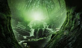 Fantasy world. Waterfall in heart of enchanted misty forest