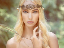Fantasy young woman in woods. Beautiful elf girl. fantasy young woman in woods stock image