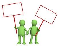 Fantoches dos pares com os posteres nas mãos Fotografia de Stock Royalty Free