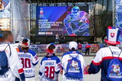 Fanzone in city Kosice during ice hockey championship 2019. KOSICE, SLOVAKIA - MAY 11: Finnish hockey fans in centre of city during  2019 IIHF World Championship royalty free stock image