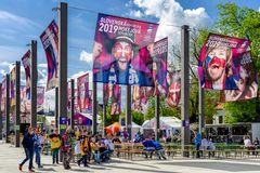 Fanzone in city Kosice during ice hockey championship 2019. KOSICE, SLOVAKIA - MAY 11: Finnish hockey fans in centre of city during  2019 IIHF World Championship stock image