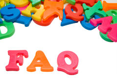 FAQ. Magnetic letters spelling out the word FAQ stock images