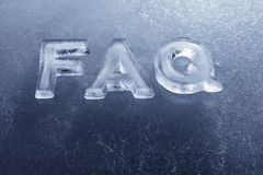 FAQ. Abbreviation FAQ (Frequently Asked Questions) made of real ice letters royalty free stock image