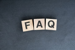 Faq. Wooden cubes spelling faq on blackbackground Stock Images