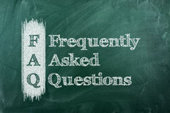 Faq. Frequently asked question ( FAQ ) concept for website service on chalkboard royalty free stock images