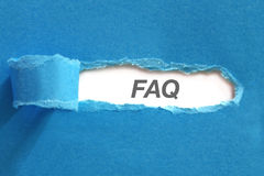 FAQ. Appearing behind blue color paper Stock Images