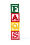 FAQ - Bloques del bebé del alfabeto en blanco Imagen de archivo libre de regalías