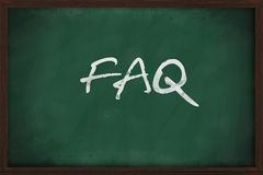 FAQ on chalkboard. FAQ frequently asked questions written on blackboard stock photography