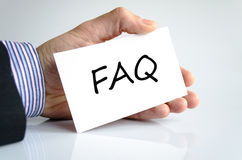 Faq Concept. Faq note in business man hand Stock Photos