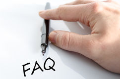 Faq Concept. Pen in the hand  over white background Faq Concept Stock Image