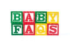 FAQ del bebé - bloques del bebé del alfabeto en blanco Foto de archivo libre de regalías