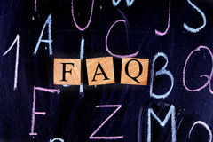FAQ on the drawing board. Wooden cubes Royalty Free Stock Image