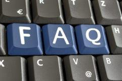 FAQ escrito com os botões azuis do teclado Fotografia de Stock Royalty Free