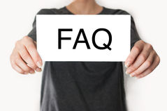 FAQ. female showing card Royalty Free Stock Photo
