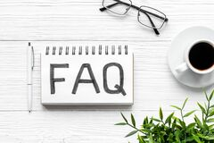 Free FAQ - Fequently Asked Question - On Notebook. Top View Stock Images - 213630564