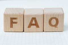 FAQ Frequently Asked Questions concept, cube wooden block with a stock photo