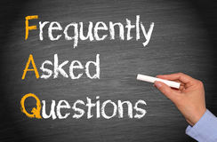 FAQ Frequently Asked Questions. Female hand with chalk and text stock image