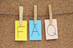 FAQ. Frequently Asked Questions sign on cork Stock Photos