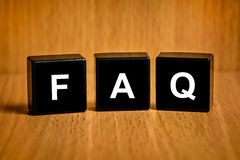 FAQ or Frequently asked questions text on block. FAQ or Frequently asked questions text on black block stock photos