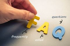 FAQ. Hand arrange wood letters as FAQ abbreviation ( frequently asked questions Royalty Free Stock Images