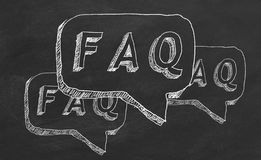 FAQ. Hand drawing text `FAQ` on black chalkboard royalty free illustration