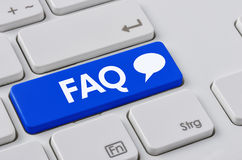 FAQ. A keyboard with a blue button - FAQ Stock Images