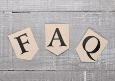 FAQ paper letter symbol motivation on wooden board Royalty Free Stock Photos