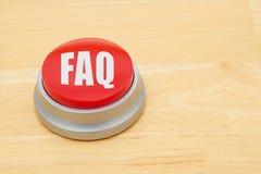 FAQ pchnięcia czerwony guzik Fotografia Royalty Free