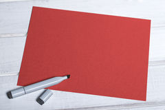 FAQ red blank board with marker. Red board with black marker lying on top Royalty Free Stock Photos