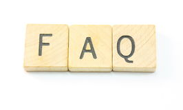 FAQ Wooden Tiles. Wooden tiles spell out the word FAQ Royalty Free Stock Photography