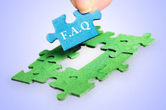 FAQ word. On blue background stock photography