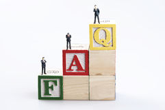 FAQ word and business man toy Royalty Free Stock Image