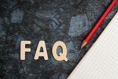FAQ word with red pencil and book paper. Question and answer con stock photos