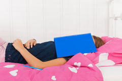 Faqlling asleep while reading a school book Stock Images