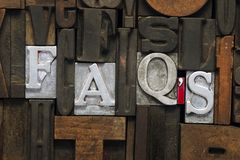 FAQs abbr. Eviation made from metallic letterpress blocks in mixed wooden letters Stock Images