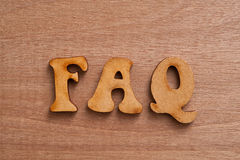 FAQs wooden background. Stock Photo