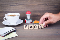 Faqs. Wooden letters on dark background Stock Photos