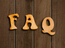 FAQs wooden letters. Stock Photo