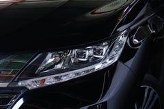 Faróis do farol do carro, os modernos e os luxuosos do carro Detalhe exterior fotos de stock royalty free
