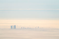 Far aerial view of Madrid city with fog in the morning Royalty Free Stock Photo